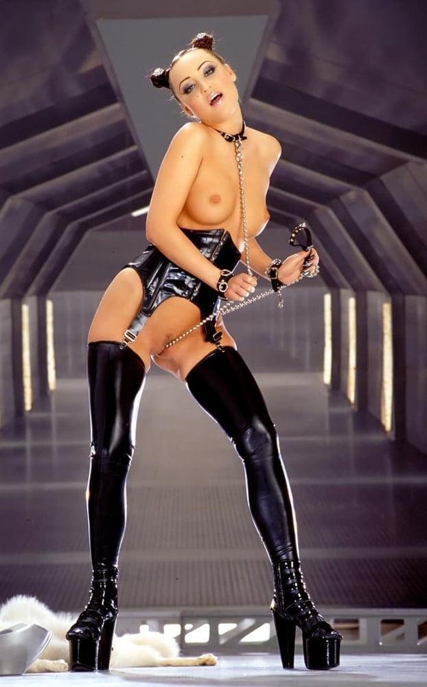Sweet aria giovanni in black latex on high heels