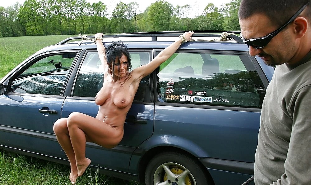 Girls naked tied to a car bonnet — img 10