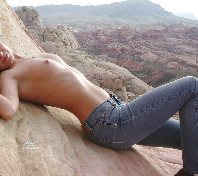 Topless girls in jeans at nature, black naked girl